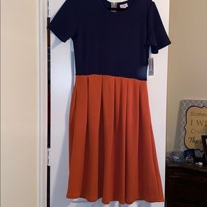 Cute orange and blue dress! With pockets
